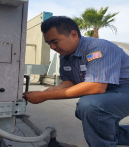 Angel Muro Servicing An Air Conditioning Unit