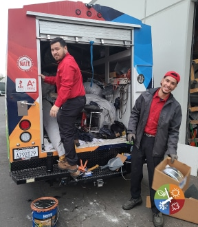Air conditioning installers working