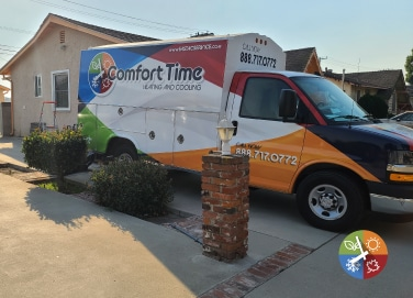 Comfort Time Heating & Cooling Installation Truck At a Home