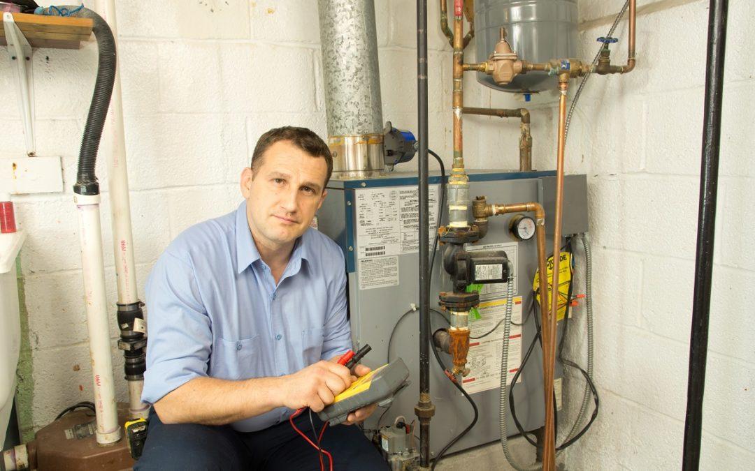HVAC Technician Fixing Gas Furnace